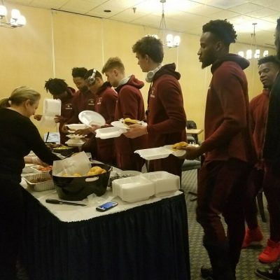 serving food to athletes