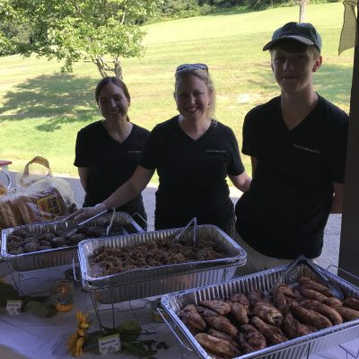 staff catering a graduation party with hot food