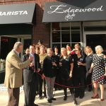 group of people at ribbon cutting ceremony for winery
