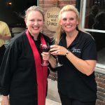 ladies posing after ribbon cutting and opening of winery