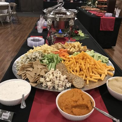 tray of cheese, vegetables and crackers with dips