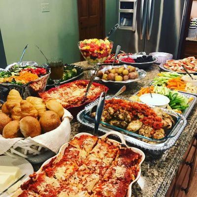personal chef services with a counter full of delicious food